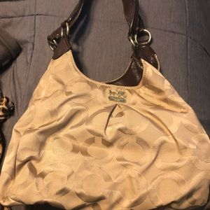 Coach purse with three compartments